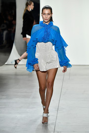 Bella Hadid looked party-ready in a mega-ruffled blue blouse at the Prabal Gurung runway show.