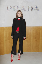 Olivia Palermo added an extra pop of red with a pair of strappy pumps by Gianvito Rossi.