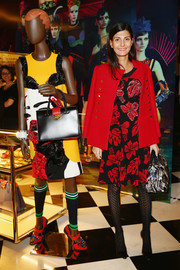 Giovanna Battaglia looked ultra stylish in a red pea coat layered over a print dress during the Prada Iconoclasts event.
