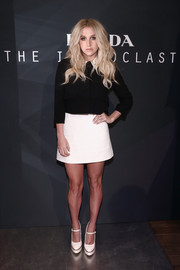 Kesha donned a black cropped jacket with a contrasting white collar for the Prada Iconoclasts event.