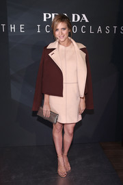 Brittany Snow attended the Prada Iconoclasts event wearing a maroon and nude Monique Lhuillier pea coat and shift dress combo.