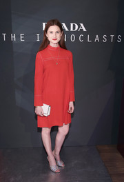 Bonnie Wright was modest yet classy in a retro-inspired, high-neck red shift dress by Prada during the brand's Iconoclasts event.