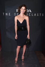 Hanneli Mustaparta turned heads at the Prada Iconoclasts event in a black strapless dress with a cat-ear bustline and a shape-enhancing, shiny waistband.