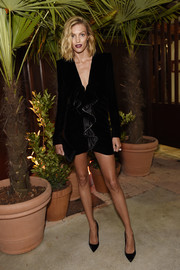 Anja Rubik cut a strong silhouette in this black velvet ruffle dress by Saint Laurent at the Prada private dinner.