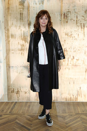 Susan Sarandon covered up in a black Prada leather coat for the label's Resort 2018 show.