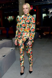 Chloe Sevigny looked whimsical in a colorful floral blouse at the Prada Resort 2019 show.