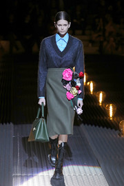 A bouquet-adorned pencil skirt completed Kaia Gerber's catwalk outfit.