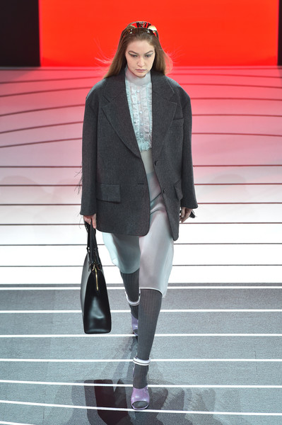 Gigi Hadid matched her jacket with a pair of gray tights.
