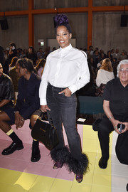 Regina King attended the Prada Spring 2020 show wearing a classic white button-down shirt.