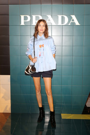 For her footwear, Alexa Chung chose a pair of black patent ankle boots.