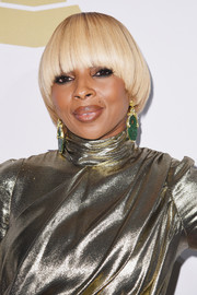 Mary J. Blige attended the pre-Grammy gala wearing her signature bowl cut.