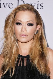 Rita Ora went for an edgy wavy hairstyle when she attended the pre-Grammy gala.
