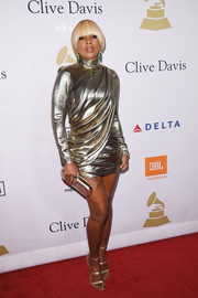 Mary J. Blige matched her dress with gold Tamara Mellon Frontline sandals.