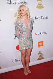 Britney Spears flaunted her toned physique in a sheer, embellished mini dress by Uel Camilo at the pre-Grammy gala.