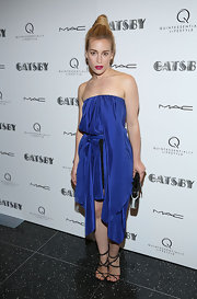 Piper Perabo showed off some skin with this strapless draped dress with an uneven hem.