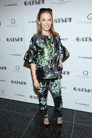 Kylie Minogue showed off her cool style with a bell-sleeved floral blouse and matching skinny pants.