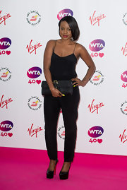 Keisha Buchanan sported a simple yet sexy black jumpsuit at the pre-Wimbledon party.