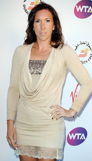 Jelena Jankovic wore a nude cowl-neck sweater dress with sequined detailing and a lace hem to the pre-Wimbledon party.