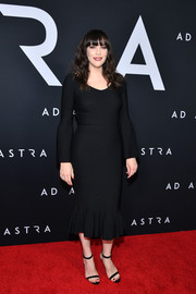 Liv Tyler complemented her dress with black ankle-strap sandals.