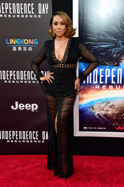 Vivica A. Fox slayed at the premiere of 'Independence Day: Resurgence' in a custom Ese Azenabor gown boasting a plunging neckline, a sheer skirt and sleeves, and a high front slit.
