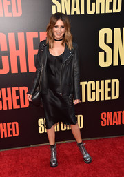 Ashley Tisdale contrasted her sultry dress with a tough-looking biker jacket.