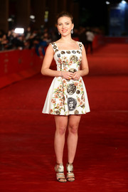Scarlett Johansson contrasted her classic dress with a pair of futuristic gold strappy sandals by Jimmy Choo.