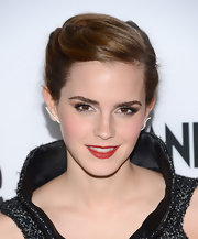 Emma's bright red lips added a touch of color to her all-gray look.