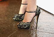 Emma Watson's bedazzled platform pumps gave her super structured frock a fun and feminine touch.