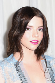 Anya Taylor-Joy opted for a face-framing wavy 'do when she attended the premiere of 'The Witch.'