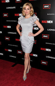 Cara paired her silver pumps with a grey dress complete with ruffled sleeves.