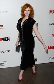 Christina Hendricks brought out the va-va-voom with this black velvet dress.