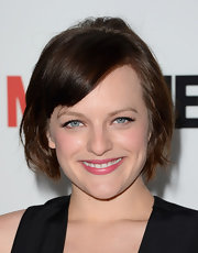 Elisabeth Moss chose a fun and flirty 'do for her red carpet look at the screening of Season 6 of 'Mad Men.'