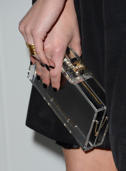 Elisabeth Moss chose a clear hard-case clutch for her sleek and sophisticated red carpet look.