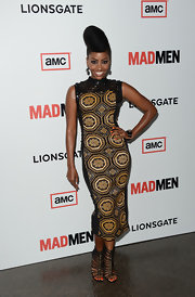 Teyonah Parris chose a black and gold print dress for her red carpet look.