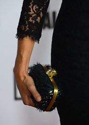 Laurie Holden added a textured touch to her lacy look with a sparkly, feather clutch.