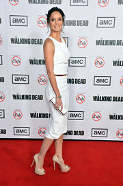 Sarah Wayne Callies' white and gold clutch perfectly matched her white dress and gold belt.