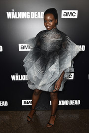 Danai Gurira looked fantastic in a sculptural striped cocktail dress by Iris van Herpen Couture at the premiere of 'The Walking Dead' season 9.