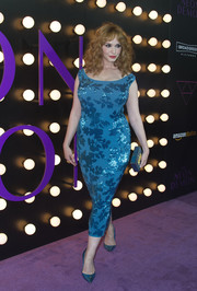 Christina Hendricks' voluptuous figure was on full display in this form-fitting blue sequin dress by Jenny Packham during the 'Neon Demon' premiere.