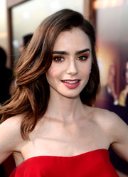Lily Collins went for a bold beauty look with a heavy application of metallic gold eyeshadow.