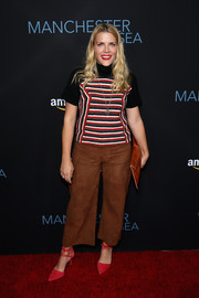 Busy Philipps paired her top with wide-leg suede pants.