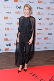 Laura Ramsey looked dramatic at the premiere of 'You are Here' in a black blouse with a floor-grazing cape.