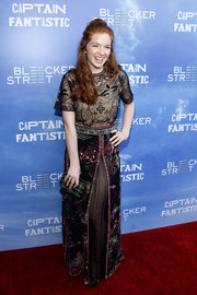 Annalise Basso complemented her dress with an elegant beaded clutch by Kate Spade.