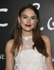 Keira Knightley swiped on some red lipstick for a pop of color to her white look.