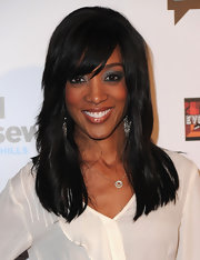 Shaun Robinson framed her face with a straight layered cut and side swept bangs.