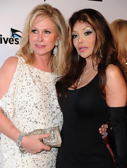 Kathy Hilton paired a glamorous beaded gold Dior clutch with her equally dazzling dress for 'The Real Housewives of Beverly Hills' party.