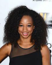 Monique Coleman went natural with this high-volume curly 'do at the 'Bridegroom' premiere.