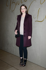 Michelle Dockery arrived for the Burberry festive film premiere wearing a classic aubergine wool coat.
