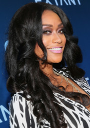 Tami Roman jazzed up her look with a mass of sculpted corkscrew curls for the premiere of 'Extant.'