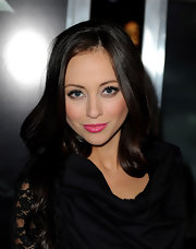 Nicole Dabeau gave her black ensemble a nice pop of color with bright pink lipstick.