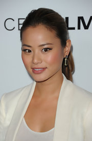 Jamie Chung attended the premiere of 'Salmon Fishing in the Yemen' wearing a sheer rosy-beige shade of lipstick.